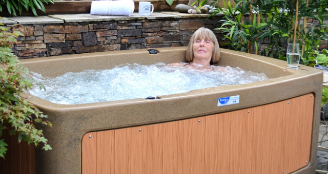 Older lady relaxing in a RotoSpa hot tub